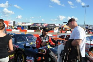 Hathaway at autograph session at Auto Clearing Motor Speedway